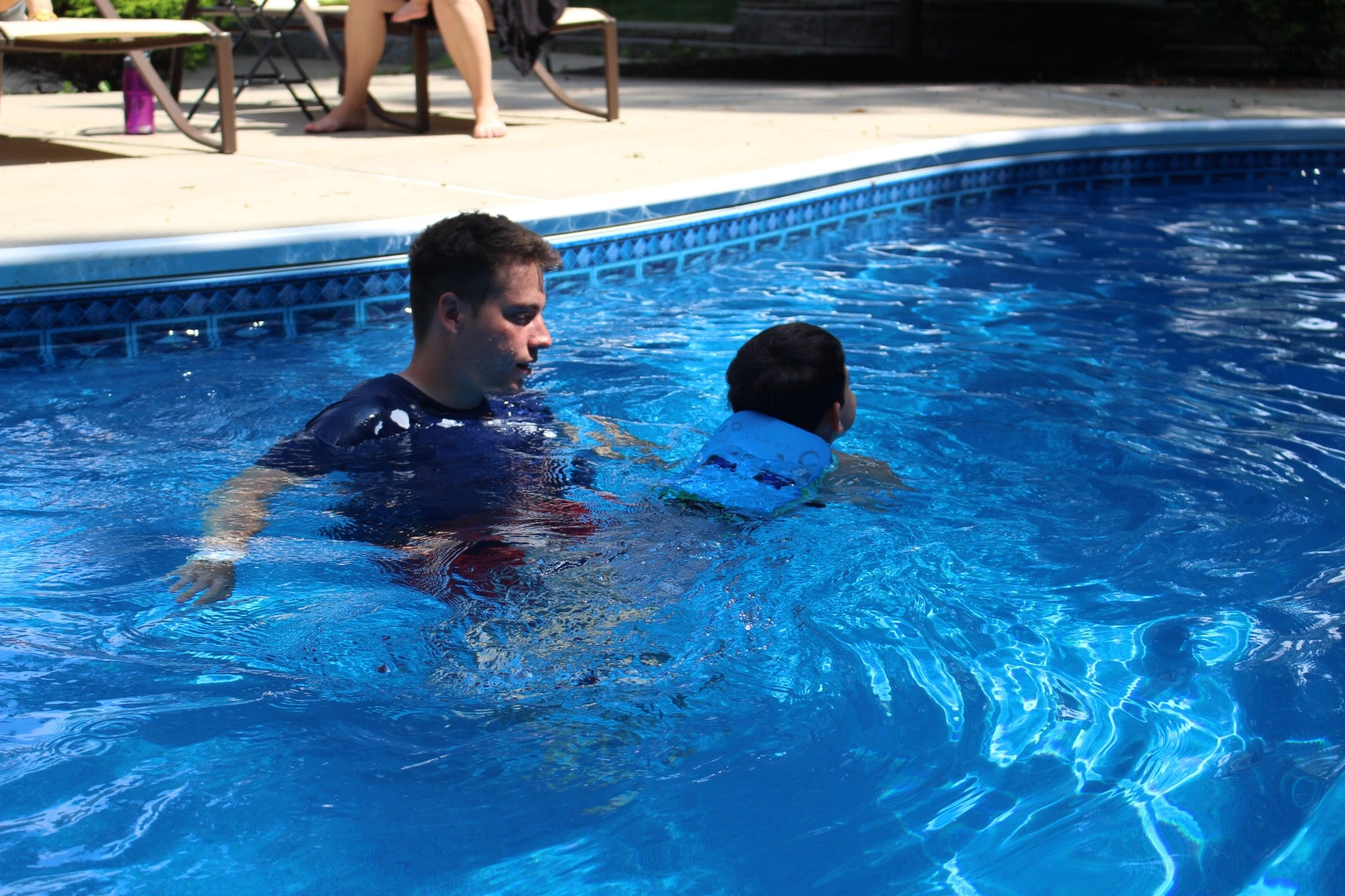 Backyard pool swim lessons