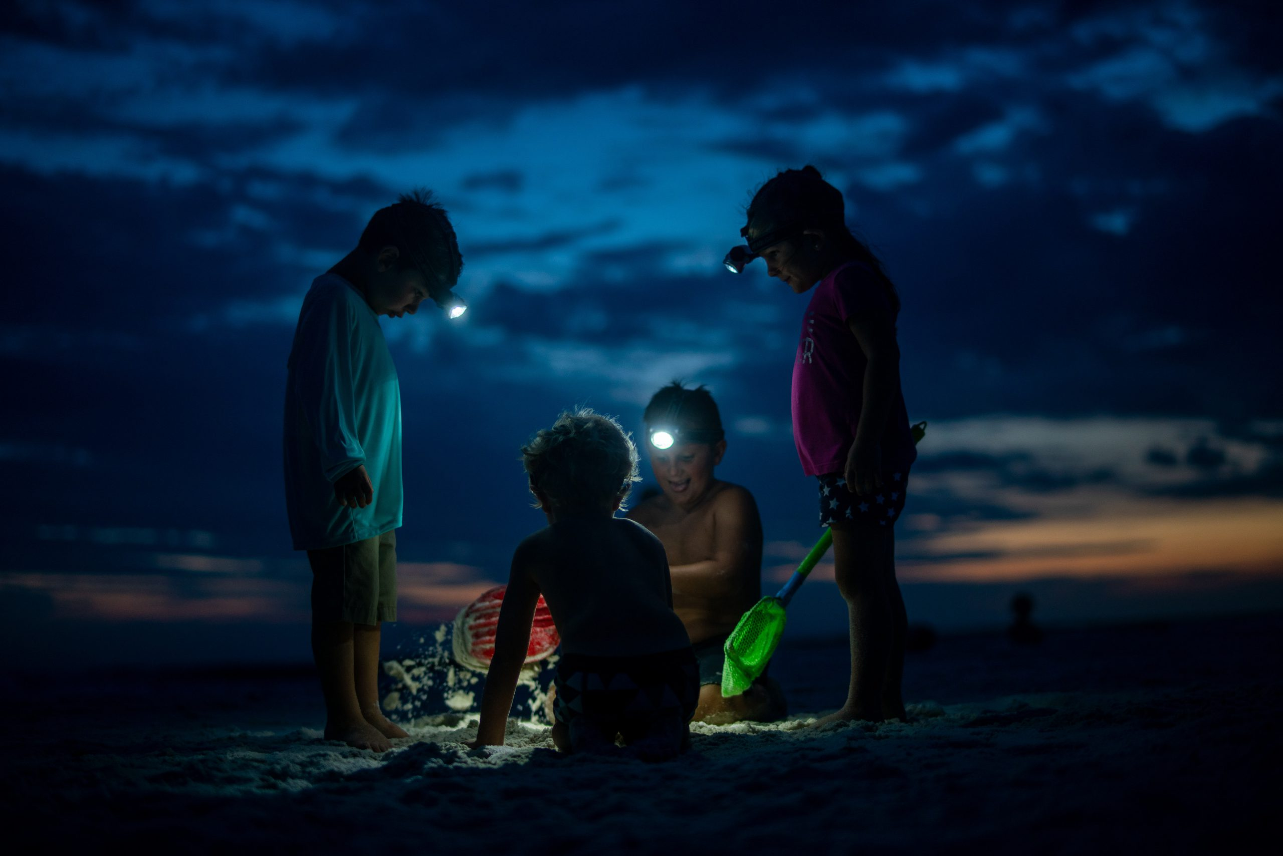 Group Of Kids On Beach At Night