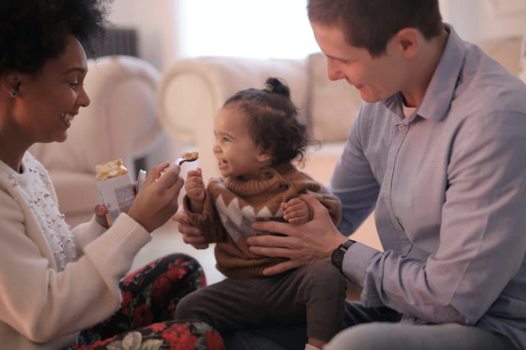 Parents Feeding Child