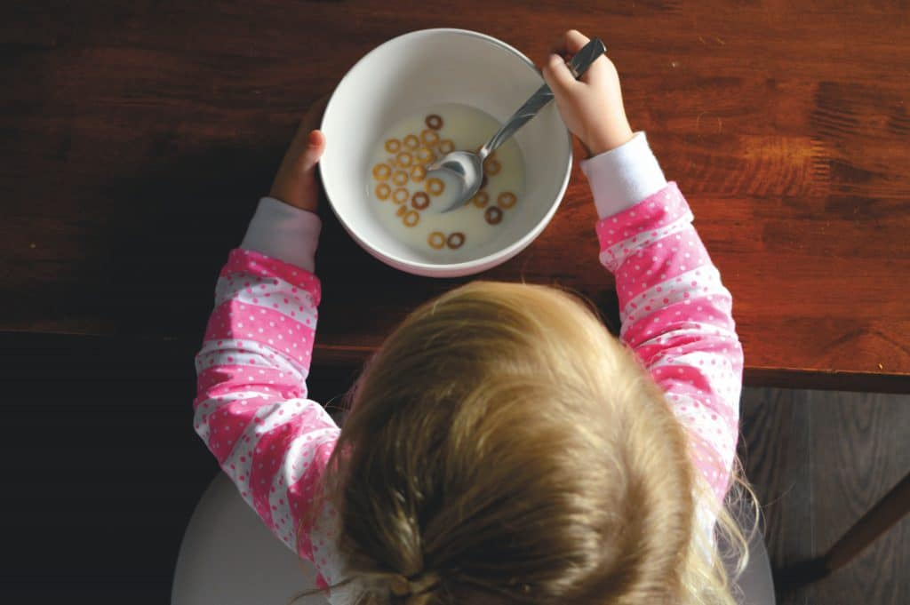 Toddler Eating Breakfast