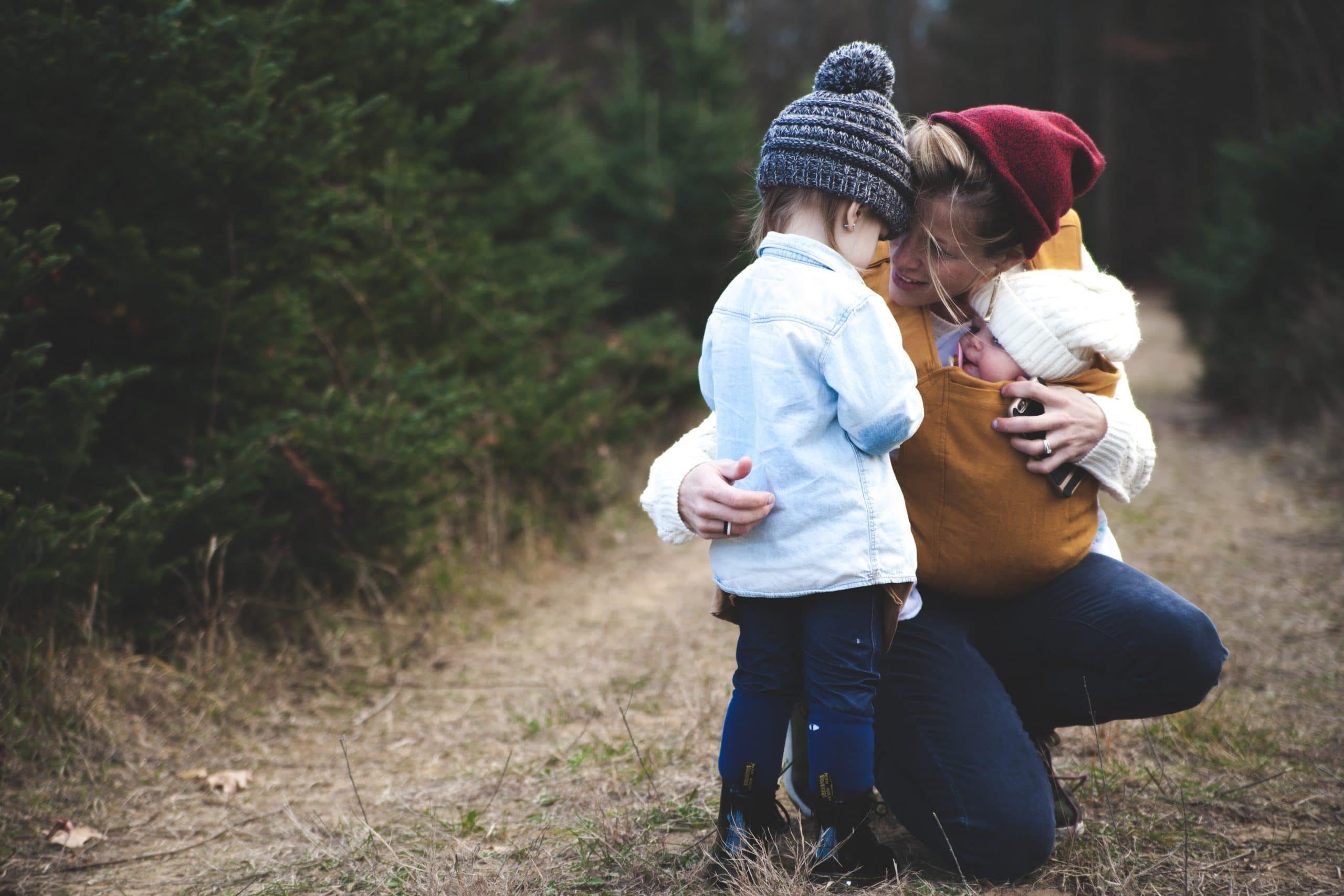 Mom Hugging Children