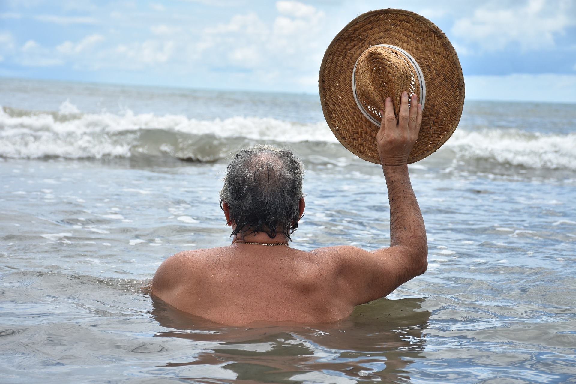 Old Man Swimming In Ocean