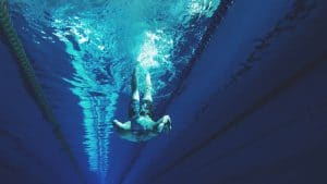 Man Swimming In Deep Water
