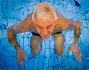 Man Taking Adult Swimming Lessons