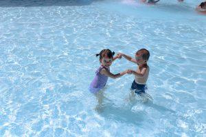 Two Children Having Swim Lessons