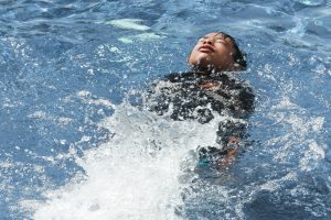 Child Swimming In Cold Water