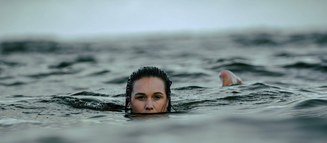 Woman Practicing Open Water Swimming