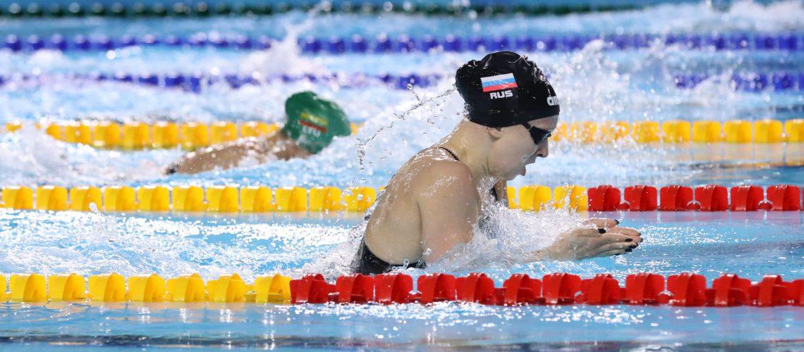 Women Swimming In Breaststroke Technique
